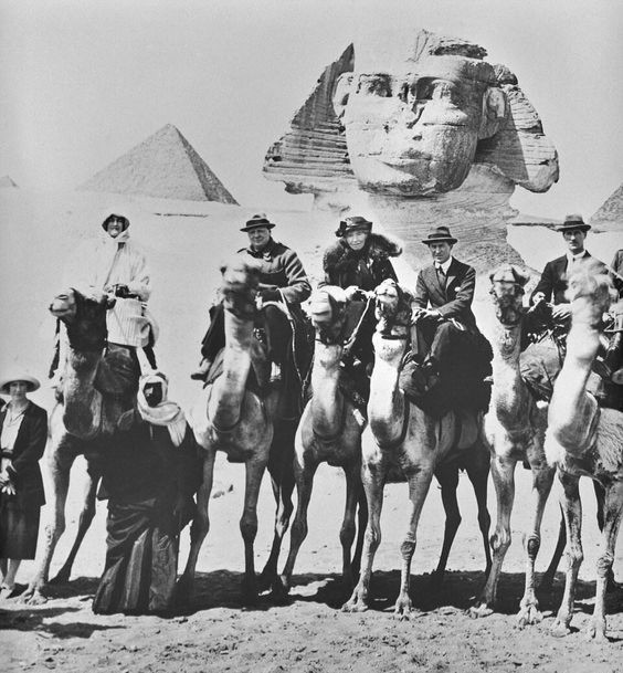 Gertude Bell and Winston Churchill pose on camels in front of the Sphinx in Egypt for the Cairo Conference of 1921