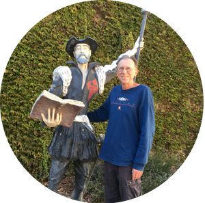 Social Worker poses with a statue of Don Quixote