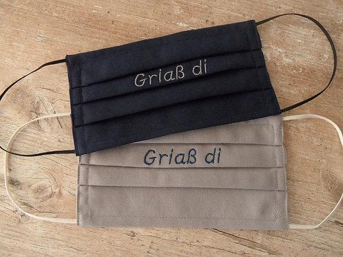 """Masken-Stickerei : """"Griaß di"""""""