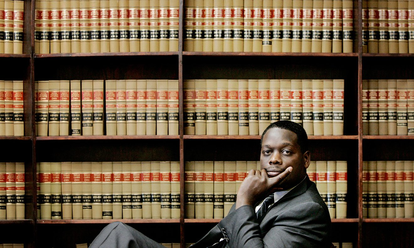 Dec. 21, 2006: Dallas County District Attorney Craig Watkins posed in his Dallas law office. At the time of this image, 19 convictions won by former DA Henry Wade and his successors had being overturned, some two-thirds of them involving black men. (AP Photo/Tony Gutierrez)  July 25, 2014: Michael Phillips, left, his lawyer Tiffany Dowling, center, and Judge Gracie Lewis looked on as Dallas County DA Craig Watkins addressed the court during a hearing in Dallas. Texas prosecutors said a project to review untested rape kits proved the innocence of Phillips, who said he pleaded guilty to a 1990 rape because his attorney advised him to avoid trial. (AP Photo)  June 22, 2017: Texas Attorney General Ken Paxton, from left, Dallas County DA Faith Johnson, center, and 1st Dallas County Assistant DA Mike Snipes, right, addressed the media during a news conference in Dallas. Johnson was the first African American woman to become DA. (AP Photo/Tony Gutierrez)  Aug. 29, 2018: Dallas County DA Faith Johnson gave a closing argument during the trial of Roy Oliver, who was convicted for the murder of 15-year-old Jordan Edwards, at the Frank Crowley Courts Building in Dallas. Edwards was killed a year earlier by a white police officer who shot into a moving car filled with black teenagers leaving a house party in Balch Springs. (Rose Baca/The Dallas Morning News via AP, Pool)  Susan Hawk talked with supporters on election night in 2014. Beginning August 2015, Hawk spent time in and out of treatment for depression and anxiety. She announced her resignation in September 2016. (Photo: Stella Chavez/KERA)  LEFT: Dallas County DA Henry Wade was named prosecutor in the murder trial of Jack Ruby in Dallas on Nov. 25, 1963. Ruby shot and killed Lee Harvey Oswald, accused assassin of President John F. Kennedy. RIGHT: Wade is pictured at his desk in this early 1970s photo. (Associated Press)