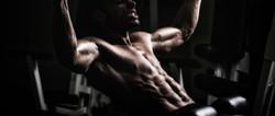 Bodybuilder Doing Heavy Weight Exercise For Back_edited