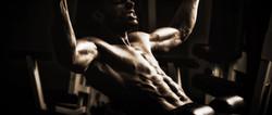 Bodybuilder Doing Heavy Weight Exercise For Back_edited_edited