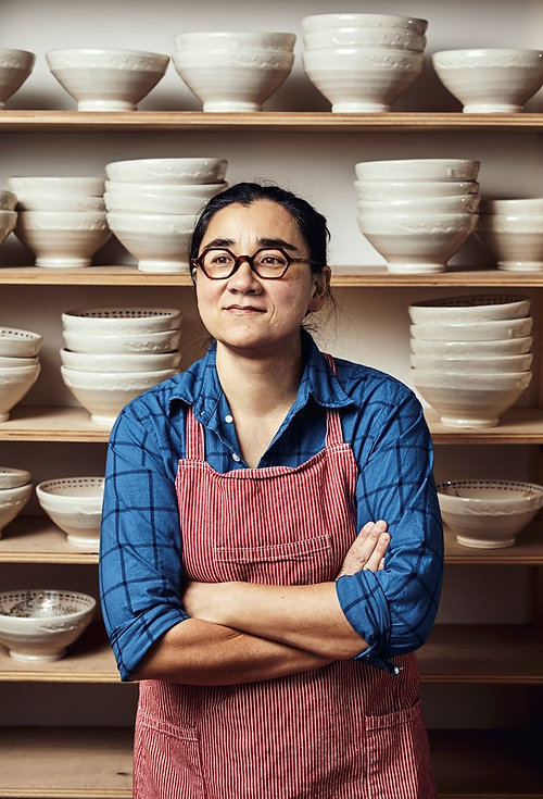 Ayumi_Horie_in-front-of-bowls-696x1024.j