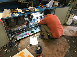Technician in the Panel on an HMT Bender
