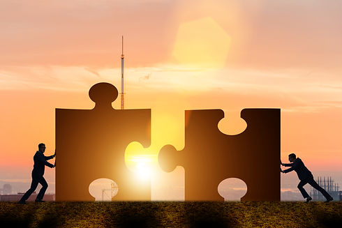 Business concept of teamwork with jigsaw puzzle.jpg