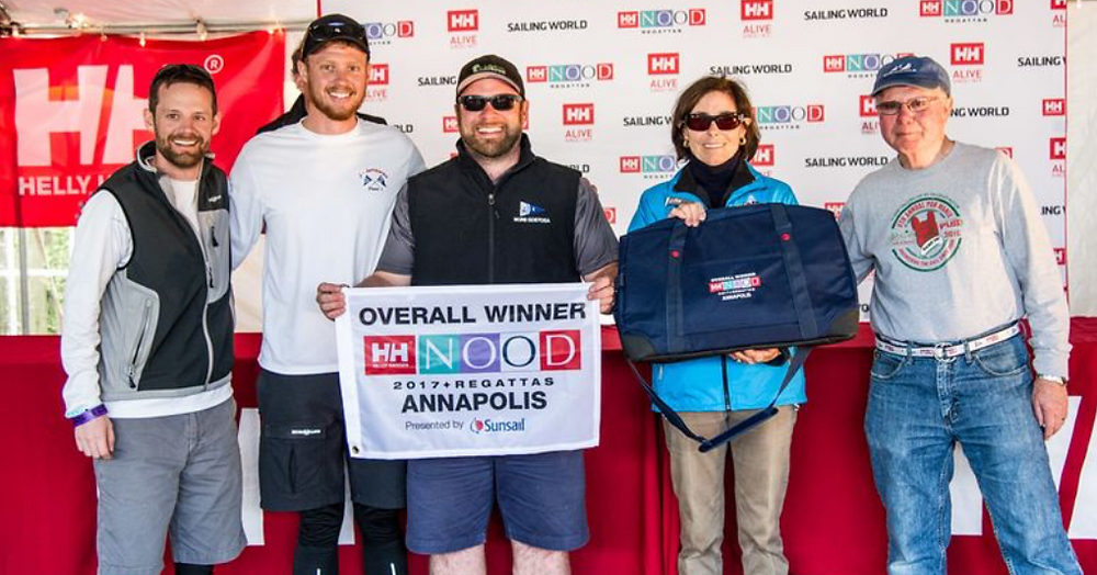 Conor Hayes (center), skipper of the J/80 MORE GOSTOSA,  overall winner. NOOD organizers select the overall winner based on the weekend's most competitive fleet. The Gilford, N.H. (Winnipesaukee YC) native's crew included his father Kevin Hayes, cousin Dan Jolda and friend Graham Philpot.