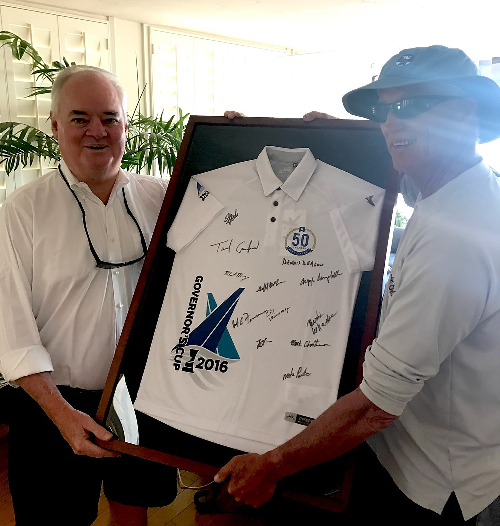 Greg Newman (right) presenting a 50th Governor's Cup shirt signed by all the skippers to Gov Cup patron Andy Rose.
