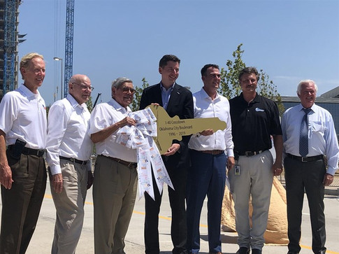 TRUST president Neal McCaleb and board member Gary Ridley were among those helping present the key to the newly opened Oklahoma City Boulevard to Mayor David Holt and Governor Kevin Stitt. Also pictured are former Secretary of Transportation and ODOT executive director Mike Patterson, current Secretary of Transportation and ODOT executive director Tim Gatz and OKC Chamber of Commerce president Roy Williams.