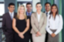 group of young businesspeople standing t