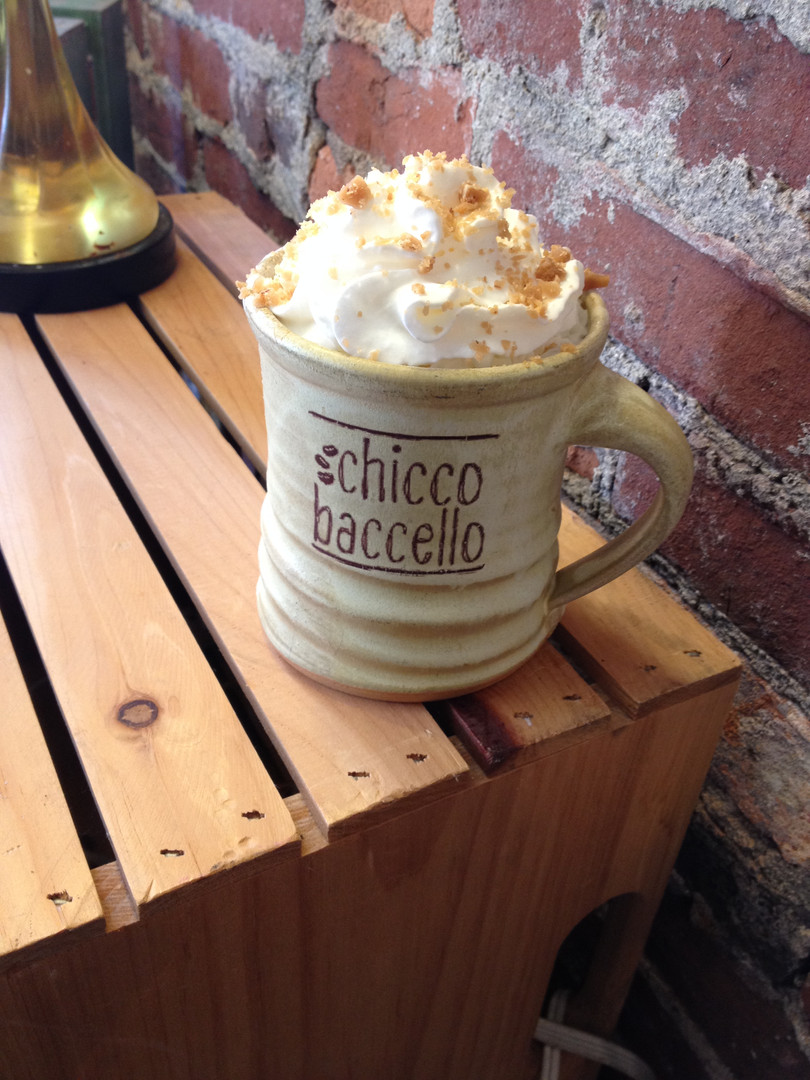 Ceramic mug with whipped cream and coffee