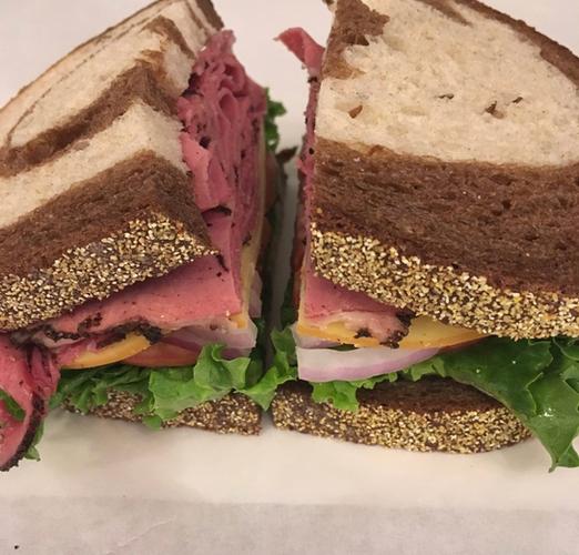 deli sandwich on rye bread
