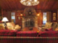 Vintage full log lake cabin living room
