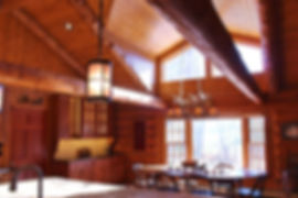 Clear story high ceiling gable kitchen in log cabin