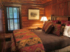 Full log cabin guest bedroom hickory bed
