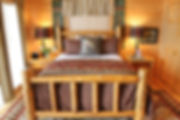 Log bed in cabin guest room