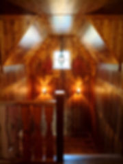 Lake cottage home full wood panel walls with mice sconces