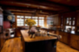 Northwoods log lodge lake home chefs kitchen butcher block island