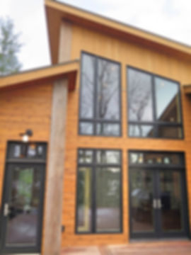 Pitched roof contemporary cabin lake home side profile