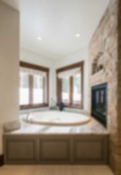 Colorado mountain home master bathroom tub fireplace