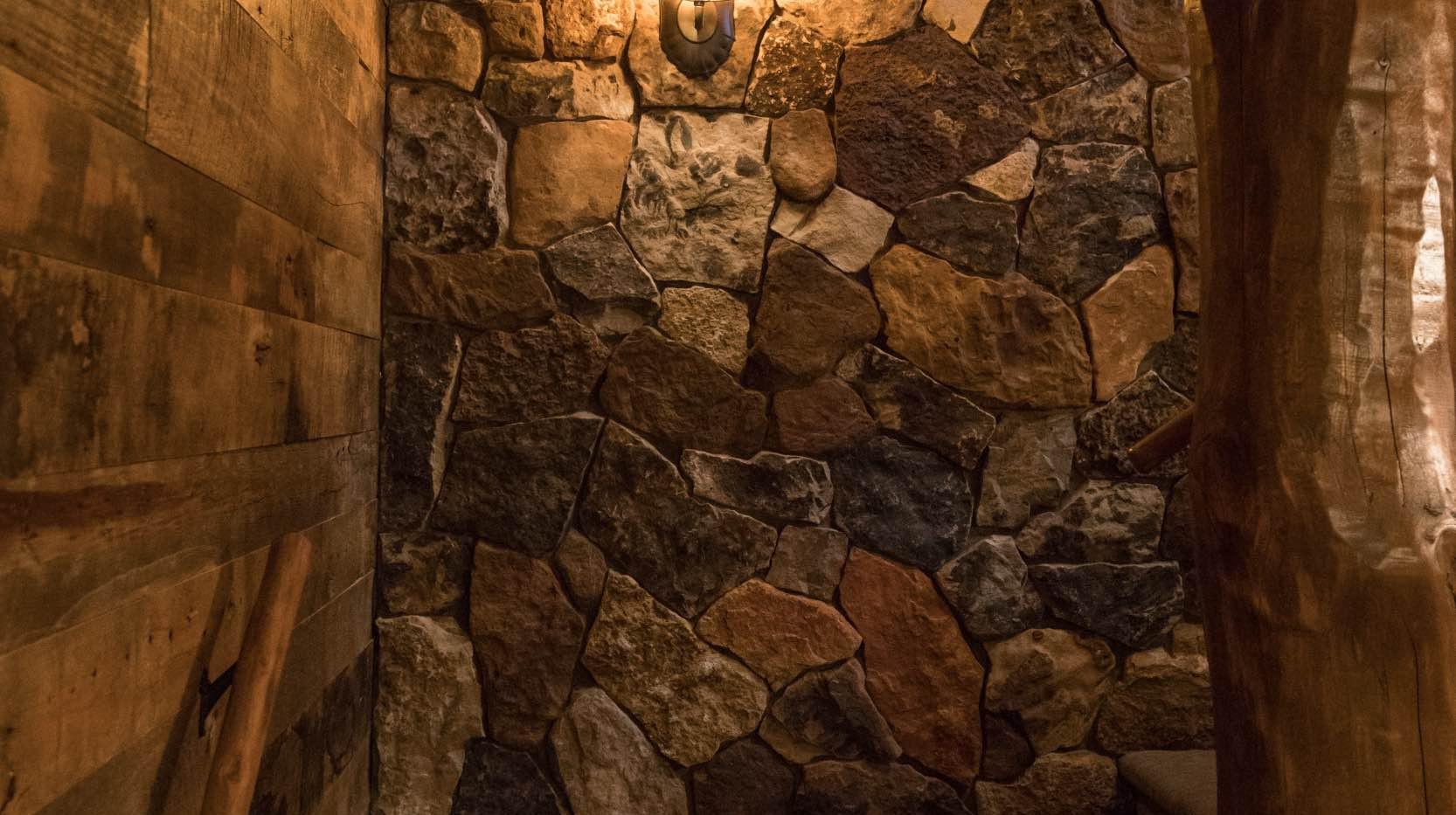 Traditional Log Home Stone Wall Detail