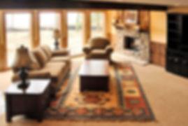 Kilim rug over carpet family room seating area