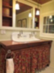 Vintage farmhouse sink log cabin bathroom