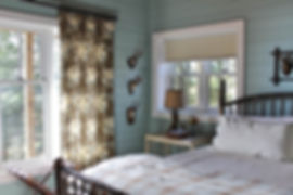 Fly fishing fabric drapes in cabin theme guest bedroom