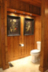 Beadboard wood wall bathroom with toilet art wall