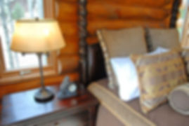 Mixed fabric cabin lodge master bedding