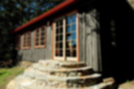Vintage Wisconsin vertical log cabin sliding glass door entry