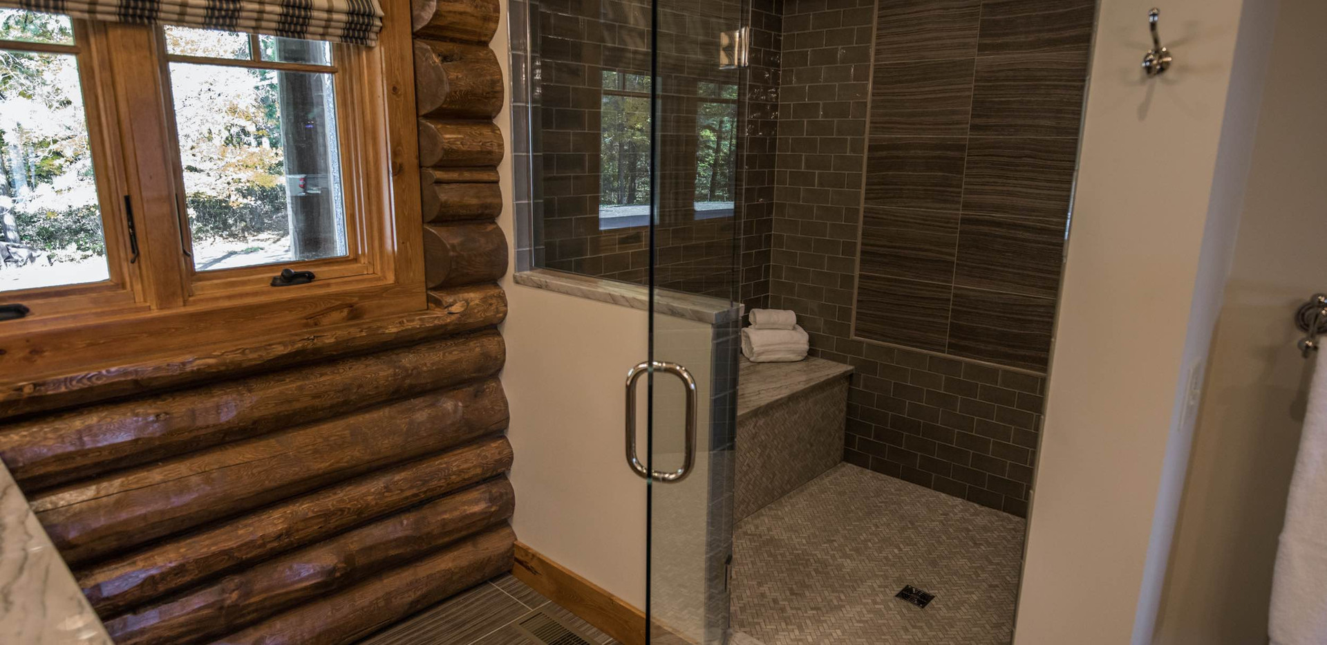 Traditional Log Lake Home Master Shower