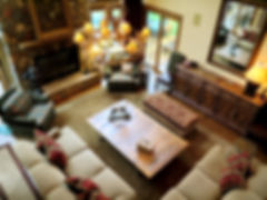 Traditional lake home great room furniture layout