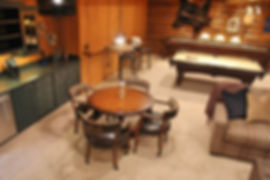 Large log lodge game recreational room with wet bar
