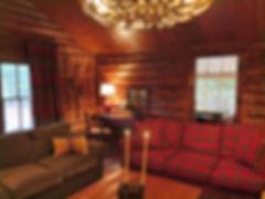 Full log cabin living room ralph lauren trade blanket drapes