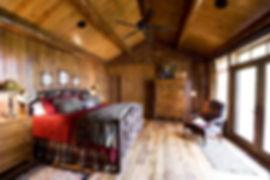 Grand log lodge master bedroom hickory bed frame