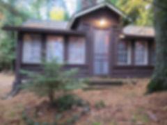 Vintage full log Wisconsin lake cabin