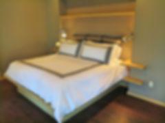 Modern built in master bedroom platform bed with grasscloth inset headboard