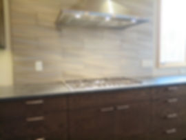 Brushed stainless steel contemporary kitchen stove back splash