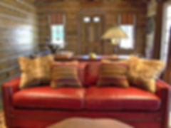 Log cabin track arm red leather apartment sofa with nail heads