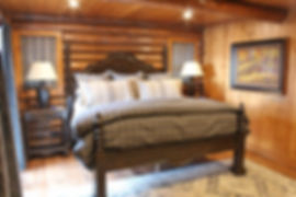 Log lodge lake home master bedroom