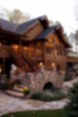 Log and stone grand entry staircase Wisconsin lake home