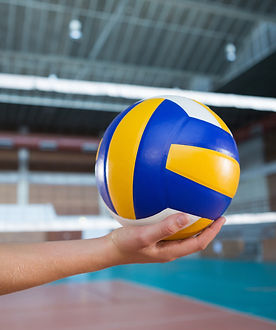 female-player-holding-volleyball-in-the-court-853PA45.jpg
