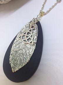 Irish bog oak necklace with silver leaf and celtic charm