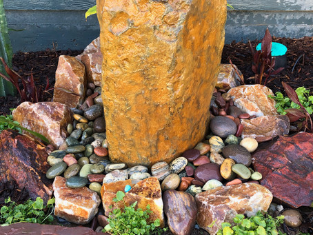 Stone Water Feature Livens Up Small Garden Space