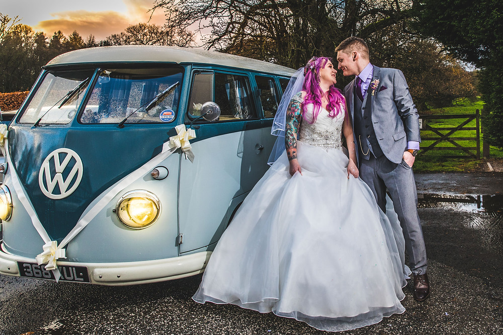 Bride and groom having photos next to a camper van