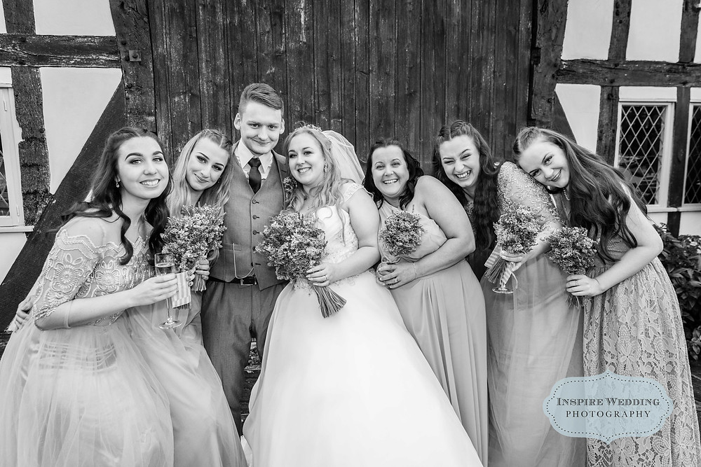 Bride and Groom with all the bridesmaids