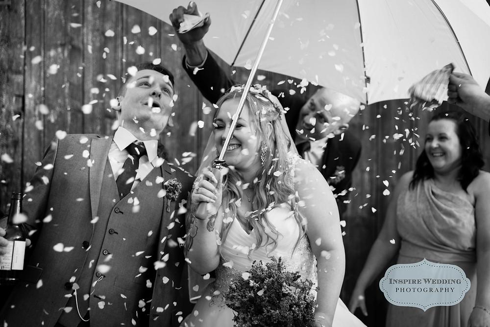 Bride and groom confetti shot, The Plough Inn, Eaton