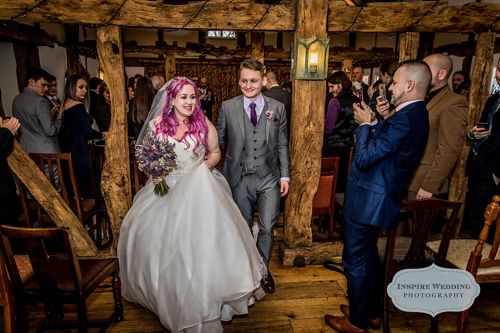 Bride and Groom walk down the aisle after getting married in The Plough Inn, Eaton
