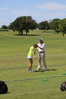 LPGA Class A Teaching Pro Jennifer Alexander of Las Vegas assists a student