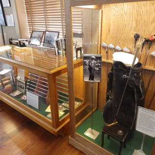 Golf clubs and bags on display